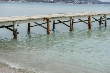 Wooden pier next to the Mediterranean sea on the island of Ibiza