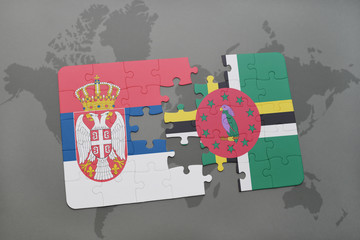 puzzle with the national flag of serbia and dominica on a world map