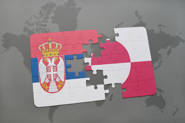 puzzle with the national flag of serbia and greenland on a world map