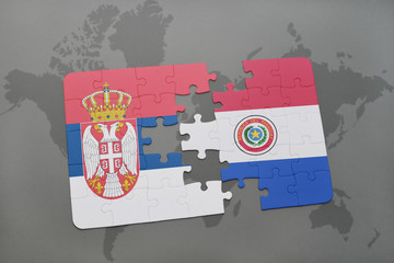 puzzle with the national flag of serbia and paraguay on a world map