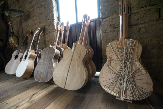 unfinished guitars in a luthier shop in Ecuador