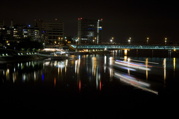Light trails on the river Rhein in Basel.