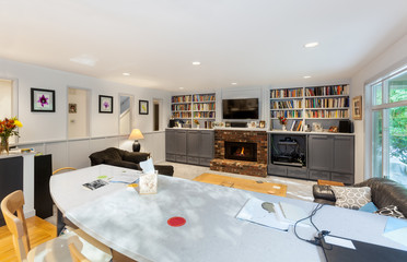 Finished family room remodel: new counter, wall openings and cabinet fronts and a gray color scheme to replace the oak