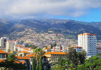 Romantic view on Funchal and mountain in smoke fog, Madeira