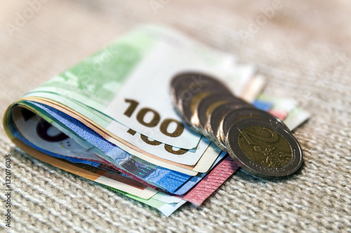 money euro coins and banknotes stacked on each other in. Black Bedroom Furniture Sets. Home Design Ideas