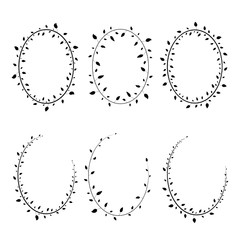 silhouettes of wreaths of twigs on white background