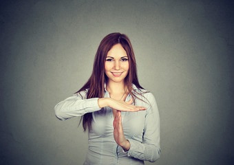 woman showing time out hand gesture