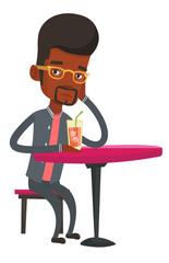 Man drinking cocktail at the bar.