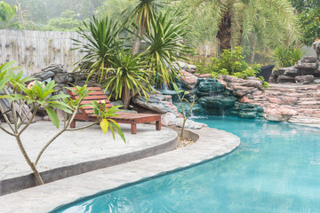 Beautiful luxury home and chair around outdoor swimming pool in hotel resort - Holiday Vacation concept with copy space