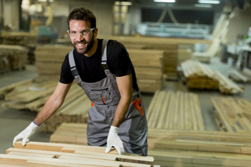 Handsome young man working in the lumber factory
