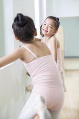 Smiling ballet girls resting in studio