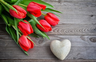 Valentines Day background with heart and red tulips