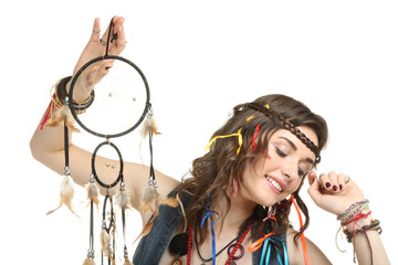 Beautiful girl holds hippies Dreamcatcher isolated on white background.