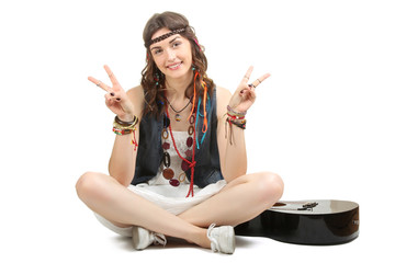 Beautiful girl hippie with a guitar isolated on white background.