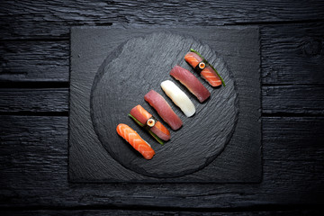 Sushi served on black slate plate