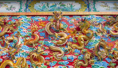 The golden dragon statue on wall