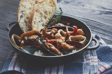 Seafood Stew in Saucepan, italian restaurant cuisine closeup