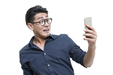 Shocked young man looking at smart phone