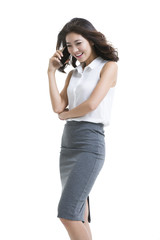 Confident young businesswoman talking on cell phone