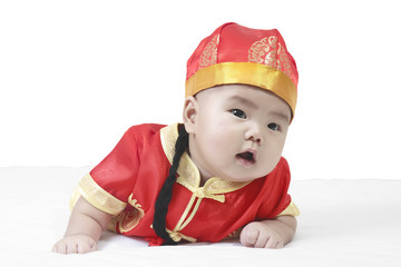 Asian cheerful and wonder baby boy wearing red Chinese suit or c