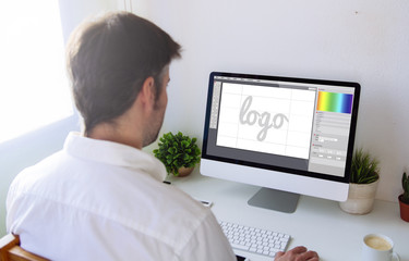 graphic designer designing a logo on computer