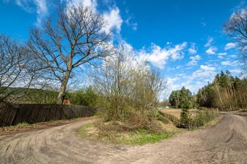 Crossroads in countryside landscape in spring