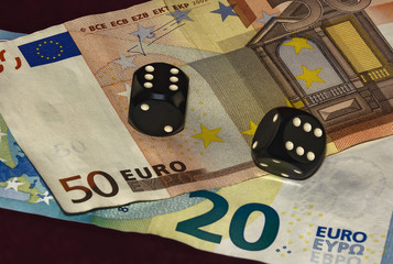 Cubes for poker and twenty of the bills and fifty euros