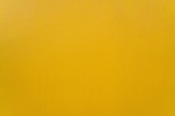 Yellow wall texture - Golden warm Background and copy space