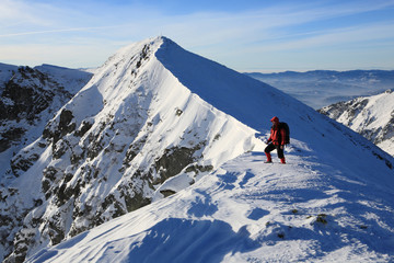 The climber climbs to the top of the mountain in the Carpathians