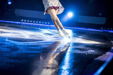 Shining led spotlights at concert with foggy background Legs of