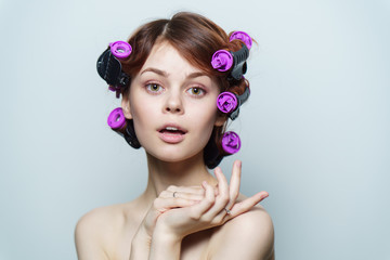 beautiful woman with purple curlers