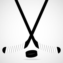 Hockey stick and puck, isolated on a white background