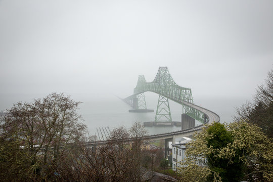 Foggy view of the Astoria-Megler Bridge in Astoria, Oregon crossing the Columbia River.