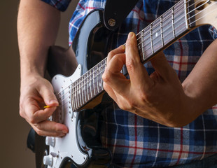 Young man playing an electric guitar