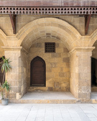 Wooden door and window covered with interleaved wooden grid at caravansary (Wikala) of Bazaraa, suited in Tombakshia street, Al Gamalia district, Medieval Cairo, Egypt