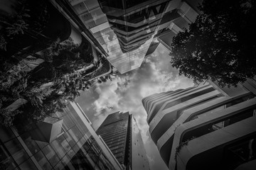 Reflex sky on downtown building with overhead perspective in black and white.