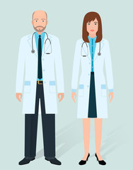 Hospital staff concept. Couple of old man and young woman doctors standing together. Medical people.
