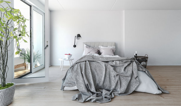 Modern bedroom interior with rumpled bedclothes