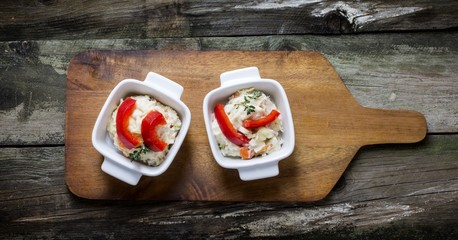 Russian salad served in two bowls,