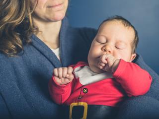 Baby wearing santa costume