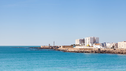 Cadiz Waterfront.  A view of the Cadiz waterfront in Spain with the Castillo de San Sebastian in the background.