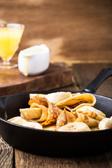 Crepes with bananas and  cream caramel sauce