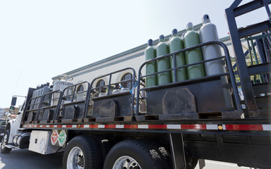 Oxygen and nitrogen tanks deliver truck. Side view. Horizontal.