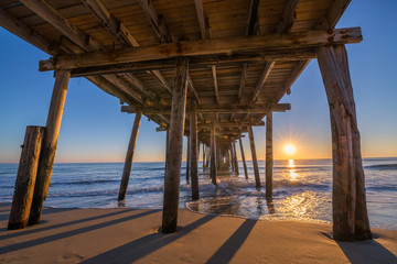 Sunrise from underneath Nags Head Pier