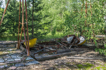abandoned swing boat in amusement park in pripyat, chernobyl area