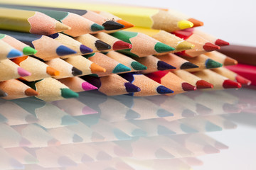 Group of sharp colored pencils with reflexions