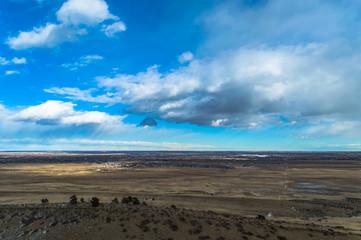 Flat Colorado landscape with blue sky.