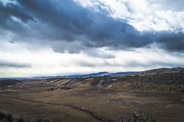 Dark clouds over Colorado mountain valley.