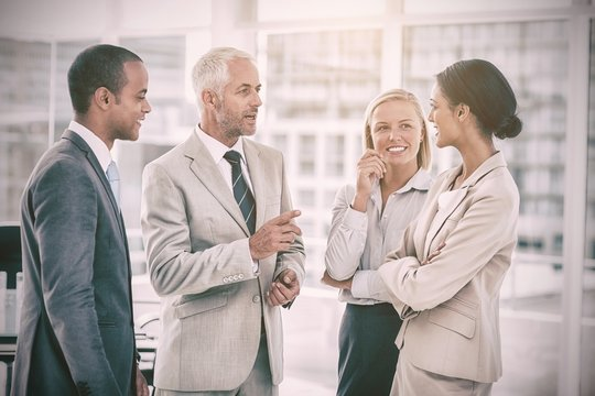 Happy business team talking