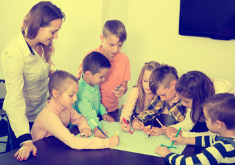 Team of elementary age children  drawing